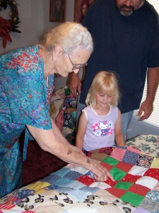 My grandmother Malinda (Smith) Beaty shows my daughter Molly a quilt she made.
