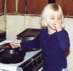 Molly preparing food at Anna Lee's -- apparently Molly did not enjoy the aroma.