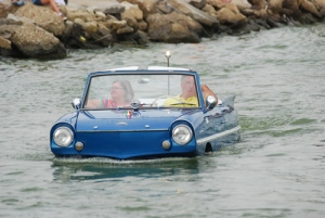 An amphicar cruises in St. Mary's Lake during the 2014 Lake Festival in Celina, Ohio.