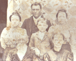 Click on Image to enlarge. Pictured, front row, William Curry and Nancy (Belle) Isabelle Claywell Curry. Their sons, Sanford (back row) and James; twin daughters Nora and Cora (uncertain of order).